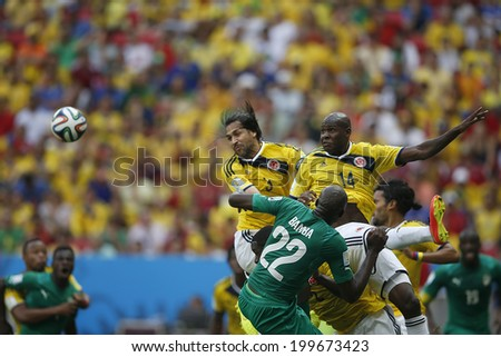 BRASILIA, BRAZIL - June 19, 2014: Ibarbo of Colombia and Bamba of Ivory Coast during the game between Colombia and Ivory Coast at Estadio Nacional. No Use in Brazil.