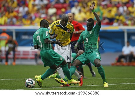 BRASILIA, BRAZIL - June 19, 2014: Ibarbo of Colombia and Tiote of Ivory Coast compete for the ball during the World Cup game between Colombia and Ivory Coast at Estadio Nacional. No Use in Brazil.