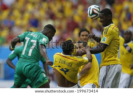 BRASILIA, BRAZIL - June 19, 2014: Juan Zuniga of Colombia and Serge Aurier of Ivory Coast compete for the ball during the  game between Colombia and Ivory Coast at Estadio Nacional. No Use in Brazil