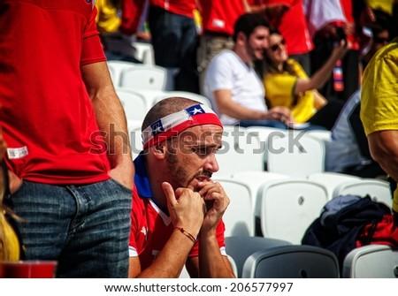 BRASILIA, BRAZIL - JUNE 23: Nervous Chilean fan biting his nails during a soccer game during the 2014 FIFA World Cup at Brasilias FIFA Fan Fest, on June 23, 2014.