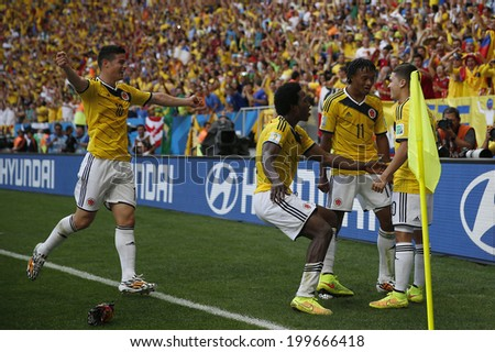 BRASILIA, BRAZIL - June 19, 2014: Players of Colombia celebrate after Quintero scores during the 2014 World Cup Group C game between Colombia and Ivory Coast at Estadio Nacional. No Use in Brazil. - stock photo