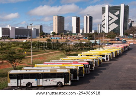 BRASILIA, BRAZIL - JUNE 6, 2015: Row of buses in the central bus station of Brasilia. The city was planned  - stock photo