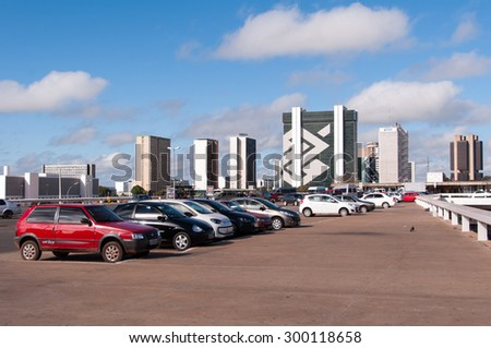 BRASILIA, BRAZIL - JUNE 6, 2015: Row of cars parked in the parking lot on the top of the central bus station of the city. - stock photo