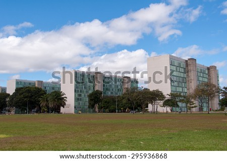 BRASILIA, BRAZIL - JUNE 7, 2015: Row of ministry buildings of Brazil government. An example of of modern urban planning by Oscar Niemeyer. - stock photo
