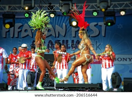 BRASILIA, BRAZIL - JUNE 16: Samba dancers entertaining the audience between games during the 2014 FIFA World Cup at Brasilias FIFA Fan Fest, on June 16, 2014. - stock photo