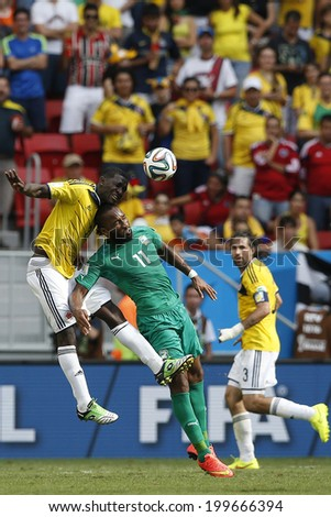 BRASILIA, BRAZIL - June 19, 2014: Zapata of Colombia and Didier Drogba of Ivory Coast during the World Cup game between Colombia and Ivory Coast at Estadio Nacional. No Use in Brazil.