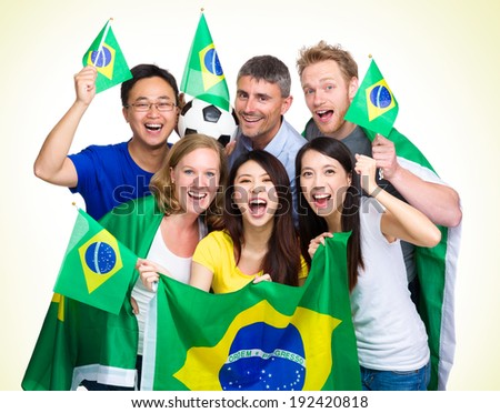Brasilian Supporter with different ethnicities - stock photo