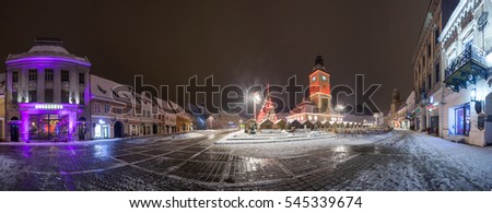 BRASOV, ROMANIA - 15 DECEMBER 2016: Brasov Council House panoramic night view with Christmas Tree decorated and traditional winter market in the old town center, Romania