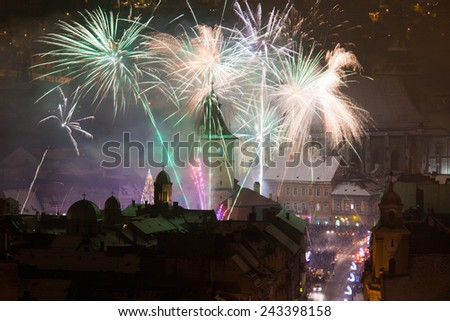 Brasov, Romania - January 1, 2012: New Year fireworks in Brasov old city center, Romania - stock photo