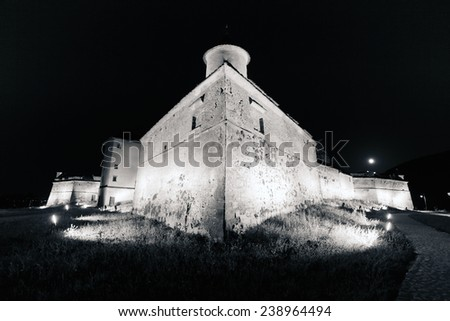 "Brasov, Romania - July 3, 2012: Old fortress ""Cetatuia"" illuminated at night, Brasov, Romania - stock photo"
