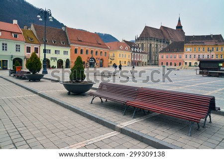 brasov, romania - march 5th, 2015: the center of the old brasov city  in romania with the famous black church in the background. shot taken on march 5th, 2015 - stock photo