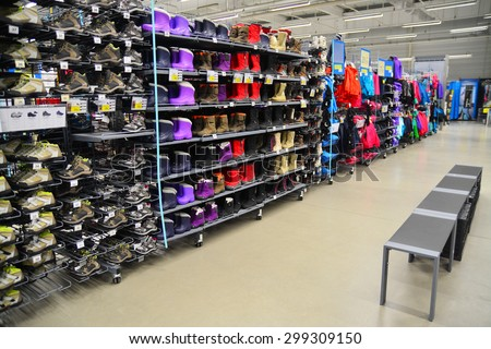 brasov, romania - march 4th, 2015: the shoe department of the decathlon sports equipment store in brasov, romania. shot taken on march 4th, 2015 - stock photo