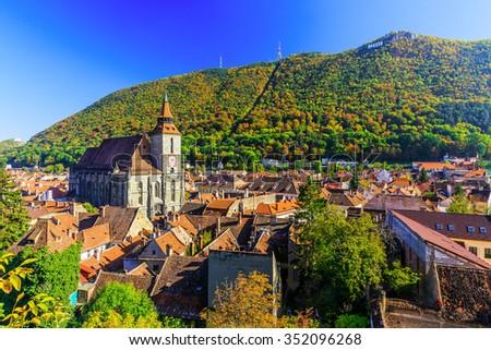 Brasov, Transylvania. Romania. Panoramic view of the old town center and Tampa mountain. - stock photo