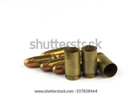Brass bullet shells, 9 size for revolver handgun - stock photo