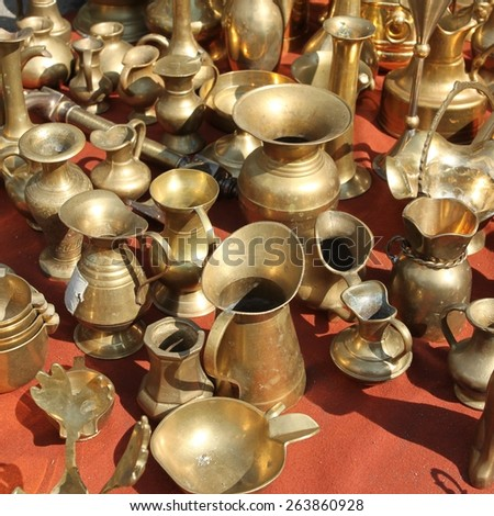 Brass containers. Vintage stuff at famous Flea Market in Bytom, Poland. - stock photo
