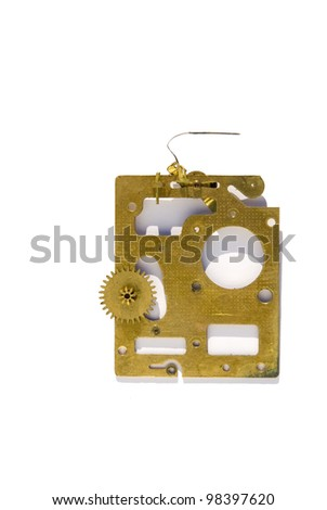 Brass detail of an antique alarm clock in a white background - stock photo