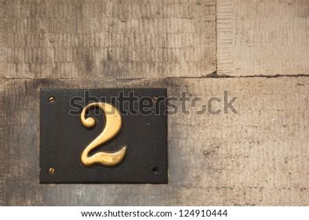 Brass Door Number 2 Mounted on Stone Facade Scotland - stock photo