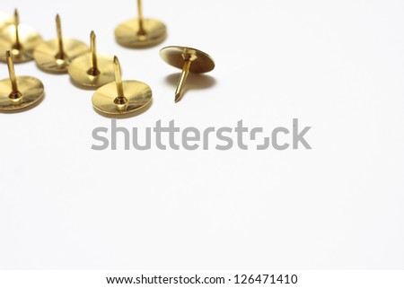 Brass drawing pins - stock photo