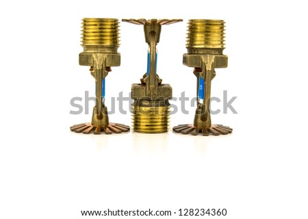 brass fire sprinklers with copy space - stock photo