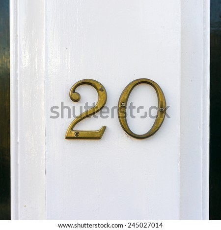 brass house number twenty - stock photo