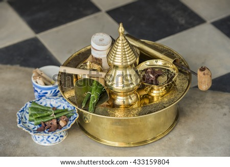 brass mortar set with betel and areca