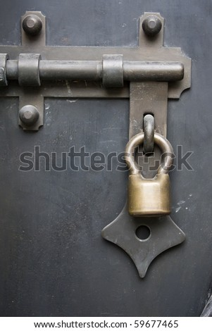 brass padlock  and chain on  old door - stock photo