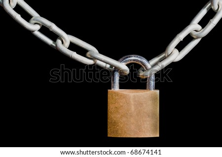 Brass padlock locked onto a heavy galvanized chain, isolated on a black background - stock photo