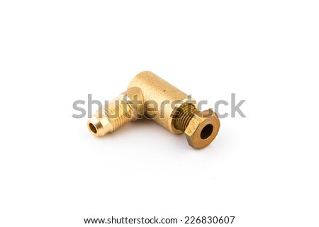 Brass parts from the car. Tube on a white background
