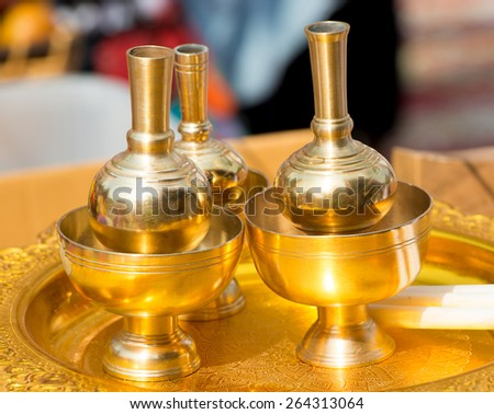 brass pitcher for pouring in ritual - stock photo