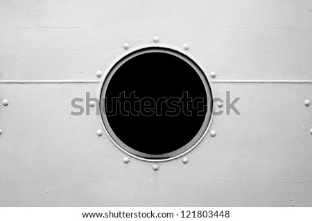 Brass porthole, ferry window frame - stock photo