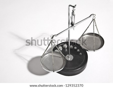 brass scales of justice on gray with shadows - stock photo