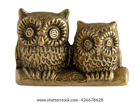 Brass statuette The pair of owls isolated on white background                                - stock photo
