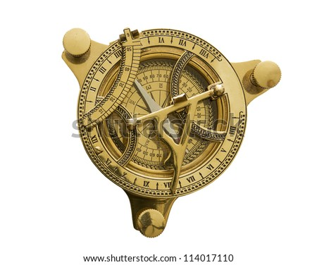 brass sundial with compass on a white background