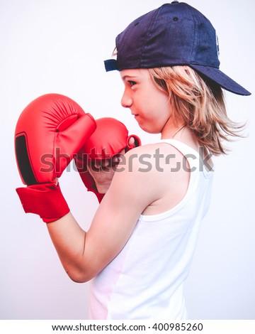 brat child fighter - filtered vintage style photo - stock photo