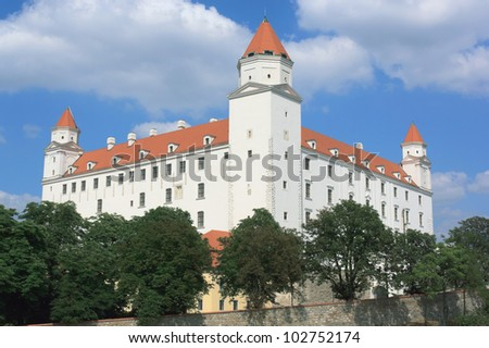 Bratislava castle (Bratislavsky hrad), a massive rectangular building with four corner towers on a isolated rocky hill above the Danube river in the middle of Bratislava, Slovakia - stock photo