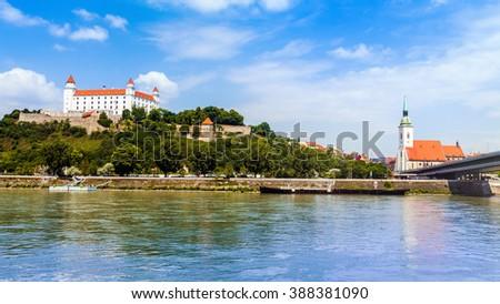 Bratislava castle,cathedral and parliament over Danube river in Brastislava city,Slovakia - stock photo