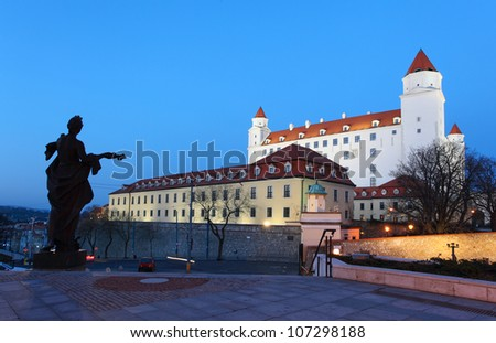 Bratislava castle from parliament at twilight with dramatic clouds - Slovakia - stock photo