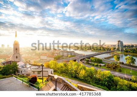 Bratislava cityscape view with modern bridge, Danube river and old town from the castle hill on the morning in Slovakia - stock photo