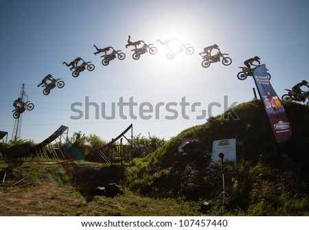 BRATISLAVA, SLOVAKIA - APRIL 28: jump sequence of Zdenek Fusek (CZE) performing trick at FMX session on April 28, 2012 in Bratislava, Slovakia (Multiple Exposure) - stock photo