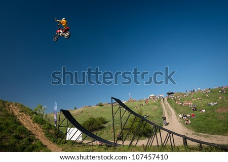 BRATISLAVA, SLOVAKIA - APRIL 28: Peter Hujber (HUN) performs trick in the air at FMX session on April 28, 2012 in Bratislava, Slovakia - stock photo