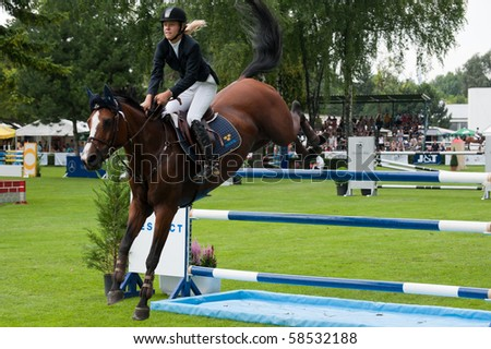 BRATISLAVA, SLOVAKIA - AUGUST 5: BELLANDER Eleonor on horse STRANDGARDENS'S MERCEDES in action during first round of qualification to Grand Prix CSIO-W*** August 5, 2010 in Bratislava, Slovakia - stock photo