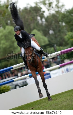 BRATISLAVA, SLOVAKIA - AUGUST 7: CROTTA Fabio on horse I.Z. CASTELLO D'ORO in action during the third round of qualification to Grand Prix CSIO-W*** August 7, 2010 in Bratislava, Slovakia - stock photo