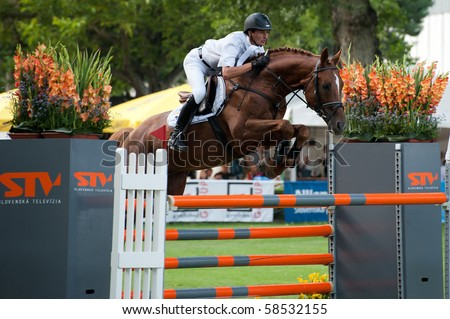 BRATISLAVA, SLOVAKIA - AUGUST 5: GLOSKOWSKI Andrzej on horse IMEQUYL in action during first round of qualification to Grand Prix CSIO-W*** August 5, 2010 in Bratislava, Slovakia