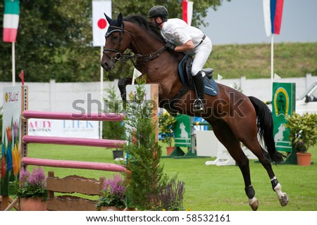 BRATISLAVA, SLOVAKIA - AUGUST 5:  HASSMANN Felix on horse NATHAN DES HAYETTES in action during first round of qualification to Grand Prix CSIO-W*** August 5, 2010 in Bratislava, Slovakia - stock photo
