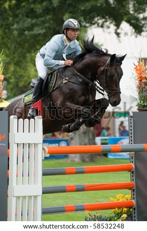 BRATISLAVA, SLOVAKIA - AUGUST 5:  KIECON Msciwoj on horse URBANE in action during first round of qualification to Grand Prix CSIO-W*** August 5, 2010 in Bratislava, Slovakia - stock photo