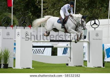 BRATISLAVA, SLOVAKIA - AUGUST 5:  LAM Samantha on horse JOCKEY CLUB CRUNSHIP in action during first round of qualification to Grand Prix CSIO-W*** August 5, 2010 in Bratislava, Slovakia - stock photo