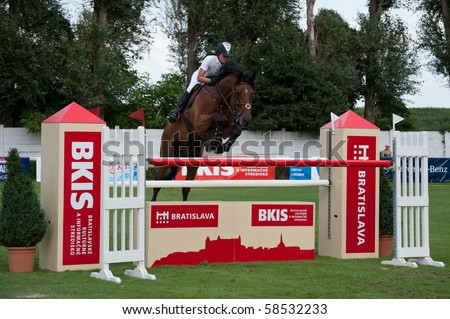 BRATISLAVA, SLOVAKIA - AUGUST 5: LEUNG Raena on horse CADANIO Z in action during first round of qualification to Grand Prix CSIO-W*** August 5, 2010 in Bratislava, Slovakia - stock photo