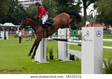 BRATISLAVA, SLOVAKIA - AUGUST 5:  NOSKOVICOVA Monika on horse LUPO 48 in action during first round of qualification to Grand Prix CSIO-W*** August 5, 2010 in Bratislava, Slovakia - stock photo