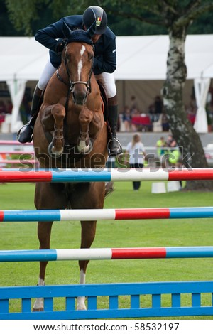 BRATISLAVA, SLOVAKIA - AUGUST 5: PHILIPPAERTS Ludo on horse VADETTA VH METTENHOF in action during first round of qualification to Grand Prix CSIO-W*** August 5, 2010 in Bratislava, Slovakia - stock photo