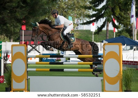 BRATISLAVA, SLOVAKIA - AUGUST 5: ROANEBROTTO Fabio on horse NEW ZEALAND DELLE in action during first round of qualification to Grand Prix CSIO-W*** August 5, 2010 in Bratislava, Slovakia - stock photo